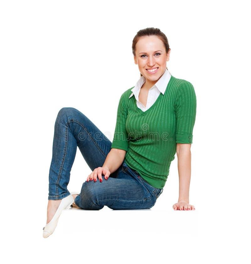 Assento da mulher nova do smiley imagem de stock