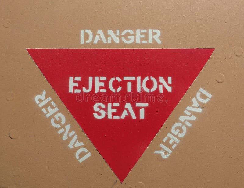 Assento de ejeção que adverte o sinal vermelho do triângulo fotografia de stock royalty free