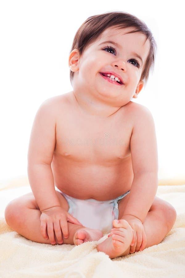 Assento e sorriso do bebê imagens de stock royalty free