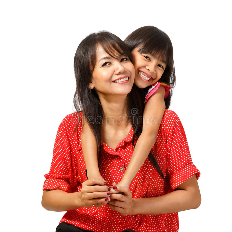 Assento feliz da mãe e da filha imagem de stock