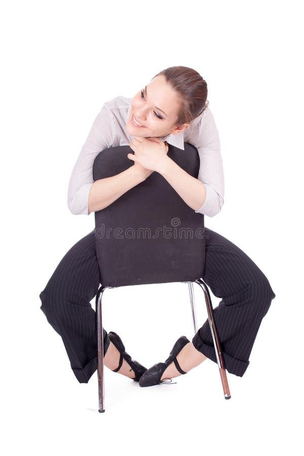 Assento na menina da cadeira imagem de stock