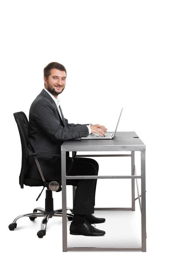 Assento novo bem sucedido do homem de negócios imagem de stock royalty free