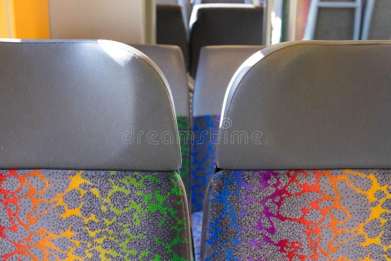 Assento público switzerland colorido da cadeira do trem do ônibus imagens de stock royalty free