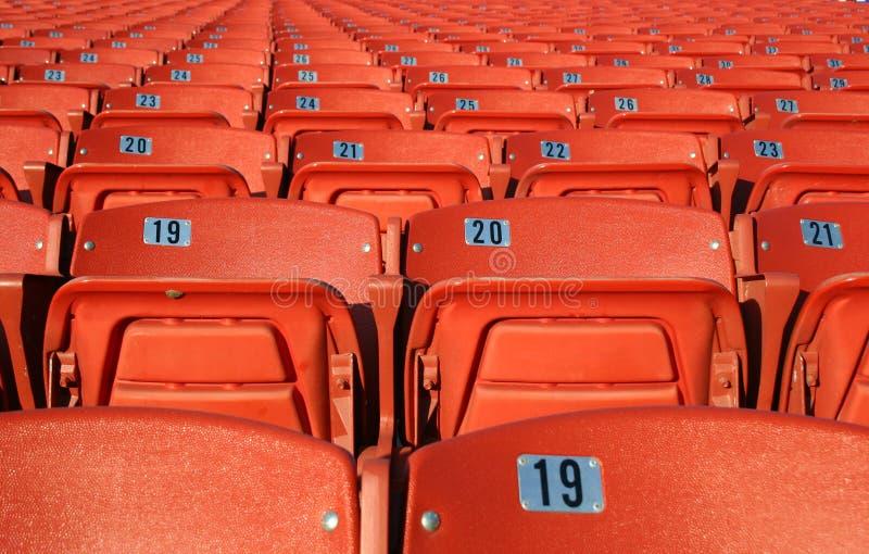 Assentos alaranjados fotos de stock