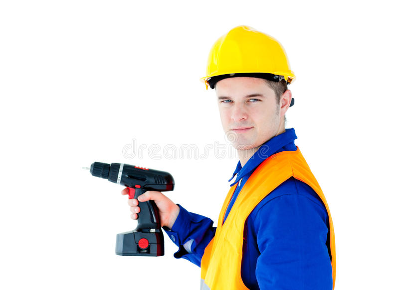 Assertive male worker holding a tool royalty free stock image
