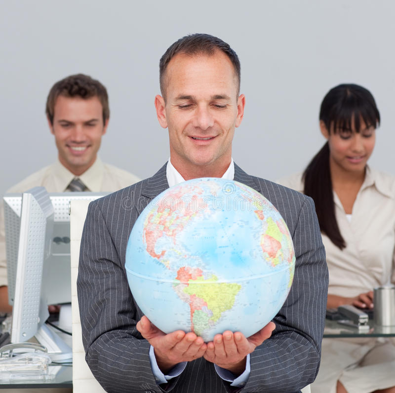 Download Assertive Manager Smiling At Global Expansion Stock Photo - Image: 12401758