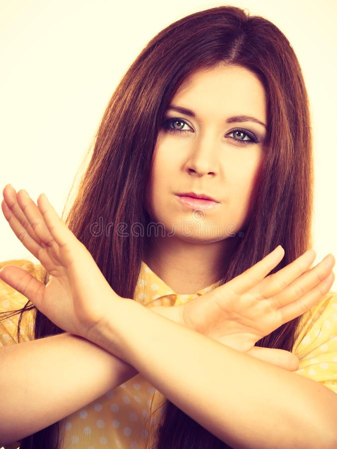 Assertive woman showing stop gesture royalty free stock photo