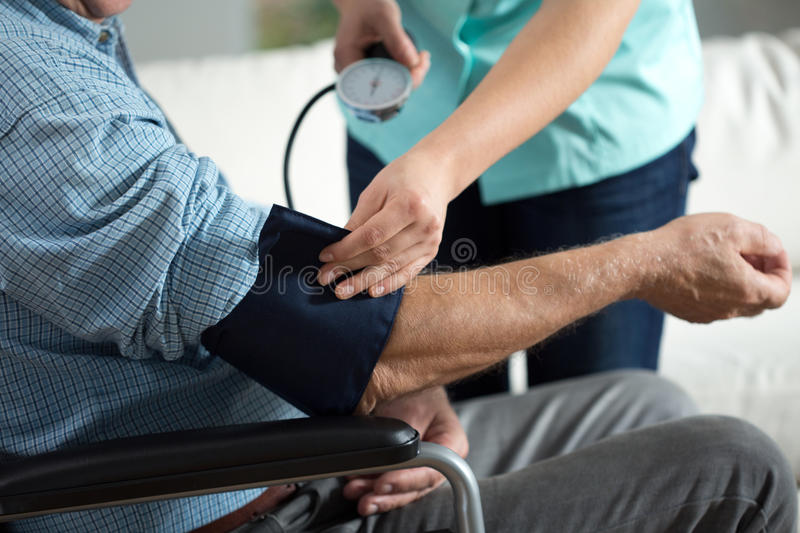 Assessment of blood pressure stock photos