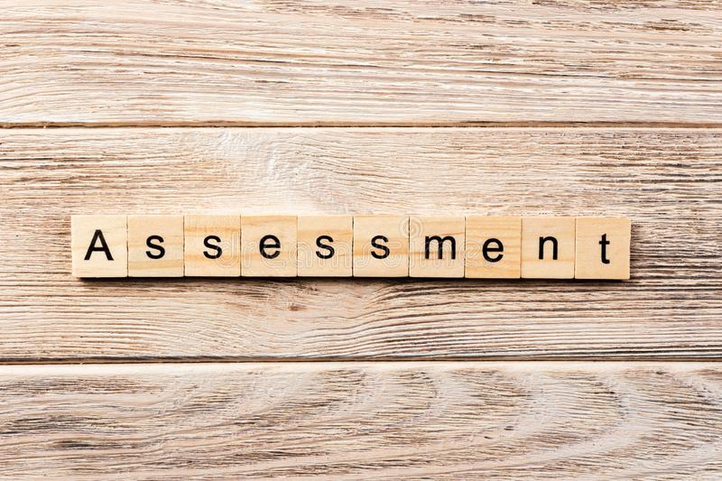 Assessment word written on wood block. assessment text on table, concept stock images