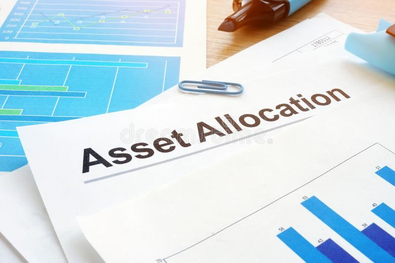 Asset allocation. Financial documents and pen. Asset allocation. Financial documents and pen on an office desk royalty free stock image