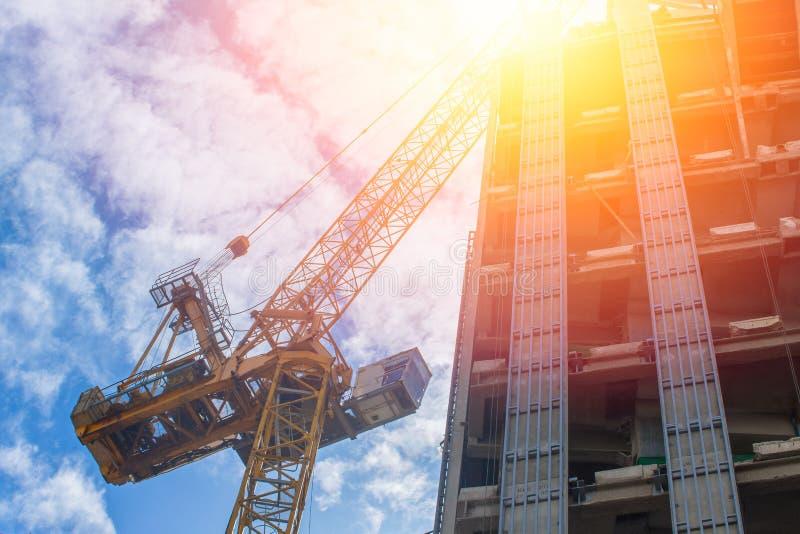 Asset development concept. Crain with under construction building. stock image