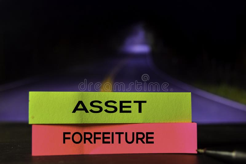 Asset Forfeiture on the sticky notes with bokeh background royalty free stock image