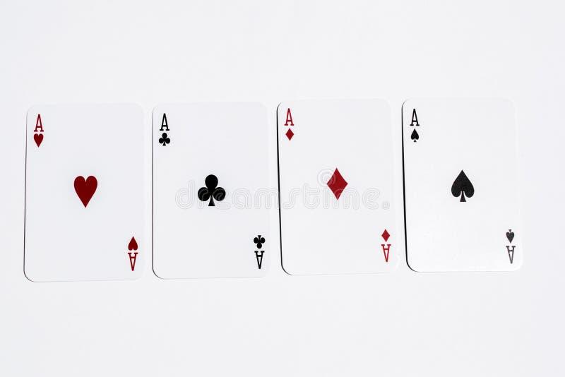 Assi della carta quattro della mazza su fondo bianco immagini stock