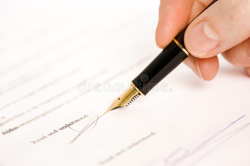 Assinatura lida e compreendida   fotografia de stock