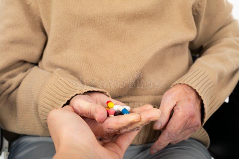 Assistência ao domicílio - drogas médicas imagens de stock