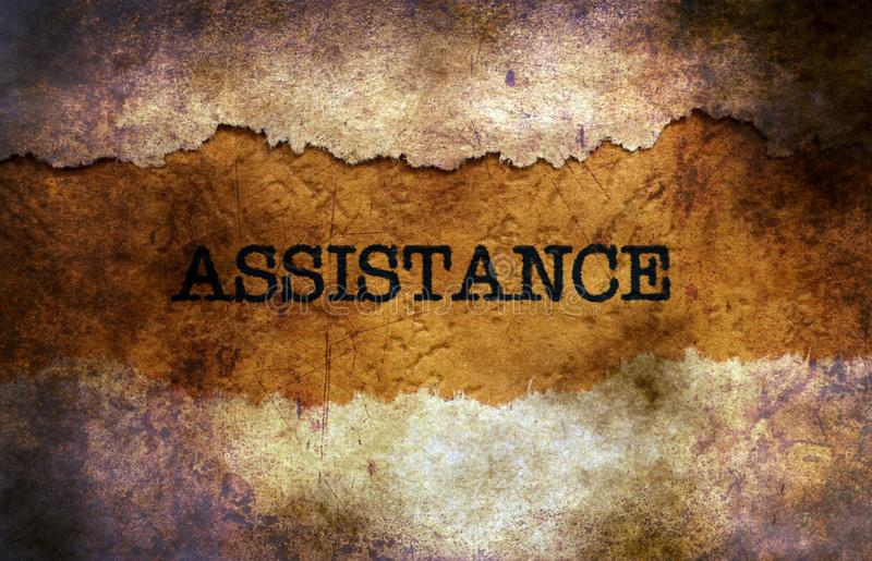 Assistance text on grunge background stock image