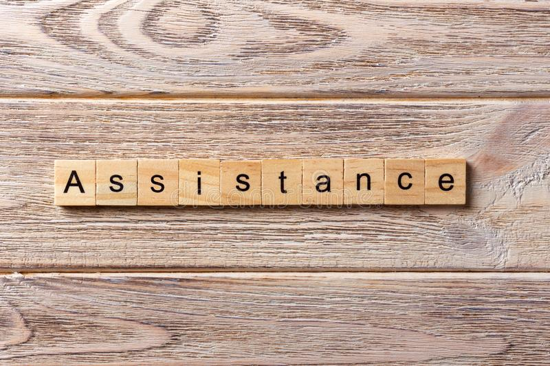 ASSISTANCE word written on wood block. ASSISTANCE text on table, concept.  royalty free stock images