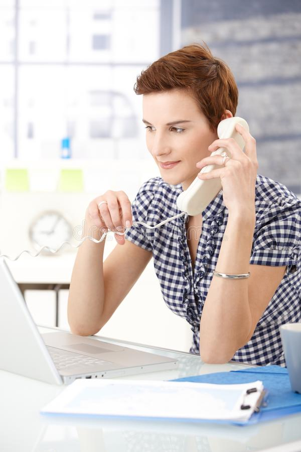 Assistant answering phone royalty free stock photo