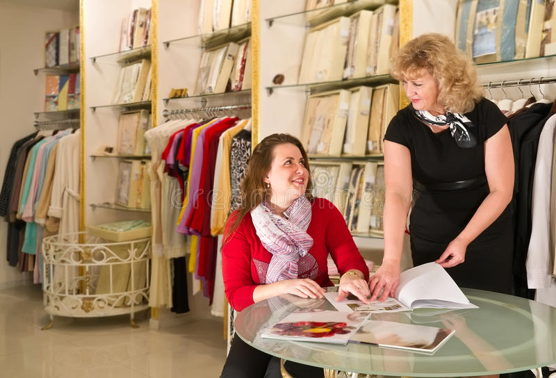 Assistant buyer at the store. And discuss the purchase of stock image