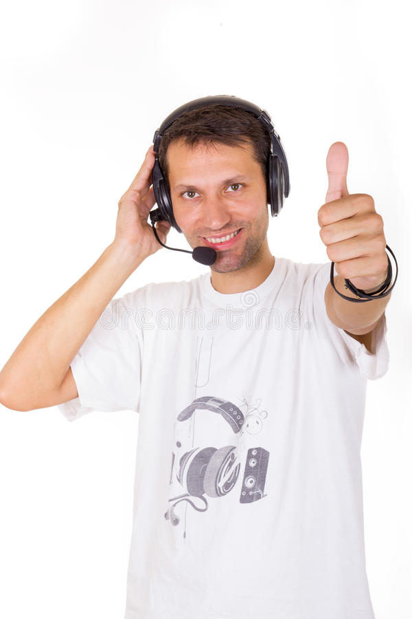 Assistant with headset showing ok with thumb up. Gesture royalty free stock images