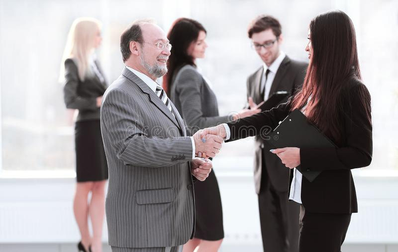 Assistant meets a businessman with a handshake. meetings and partnership royalty free stock photography