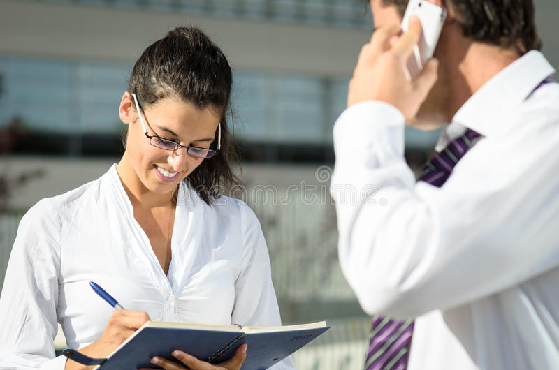 Assistant writing notes royalty free stock photos
