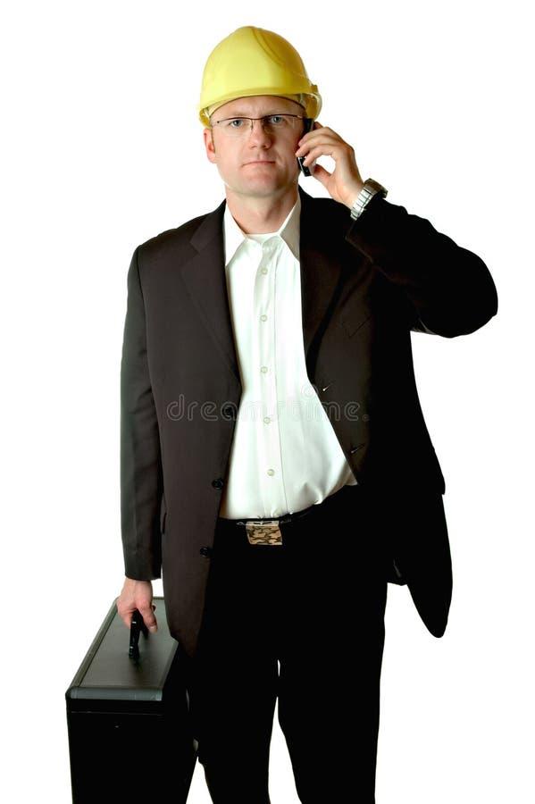 Assistente tecnico con il cellulare fotografia stock libera da diritti
