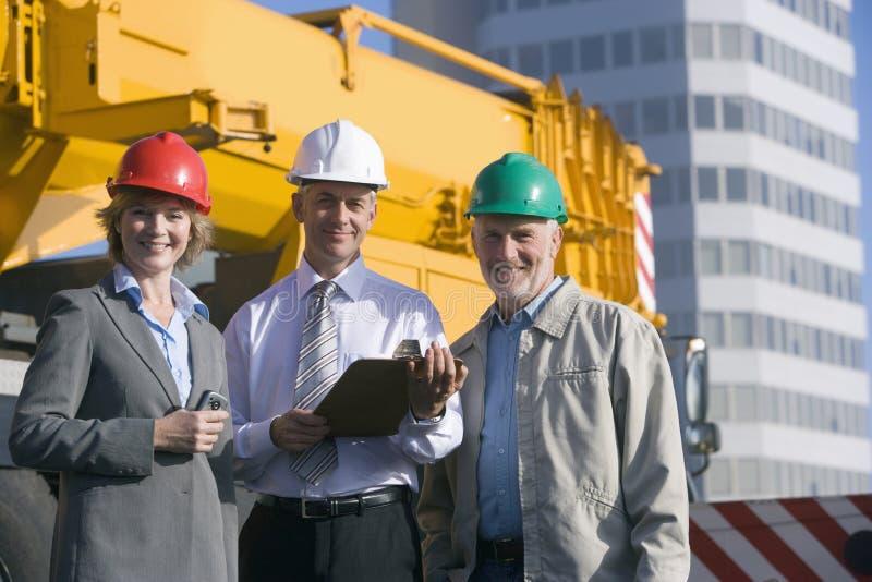 Assistenti tecnici di costruzione immagini stock
