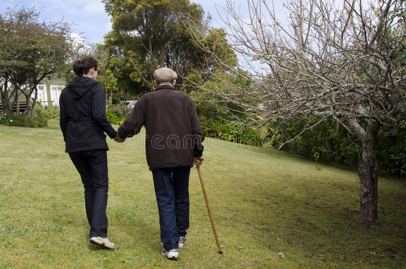 Assisting and helping elderly people stock photos