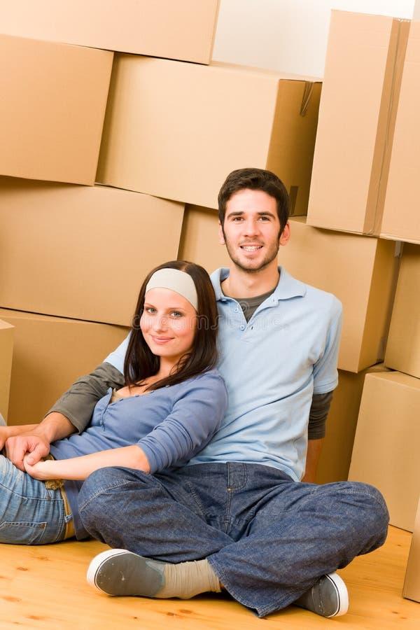 Assoalho de assento dos pares novos home novos moventes fotografia de stock royalty free