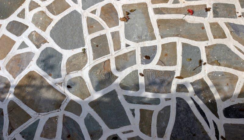 Assoalho de pedra de Cycladic imagem de stock royalty free