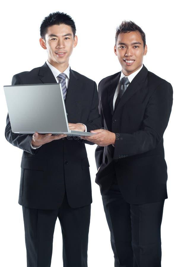 Associés asiatiques d'équipe d'affaires image stock