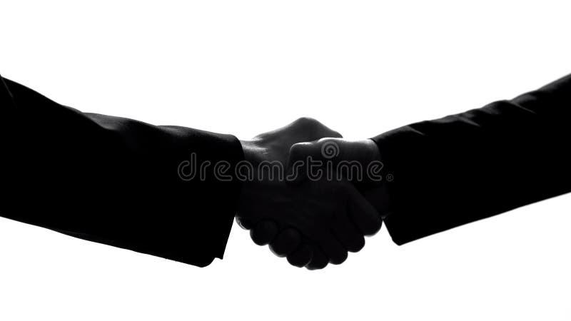 Associés se serrant la main, accord d'entreprise, coopération de collègues images libres de droits