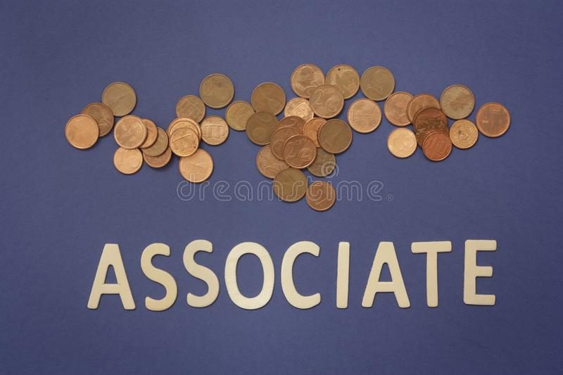 Associate written with wooden letters on a blue background. To mean a business concept stock photography