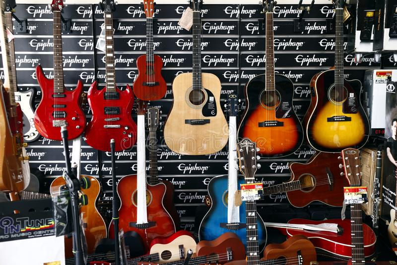 Assorted acoustic and electric guitars on display at a music store. SAN JUAN, METRO MANILA, PHILIPPINES – AUGUST 21, 2019: Assorted acoustic and electric stock photography
