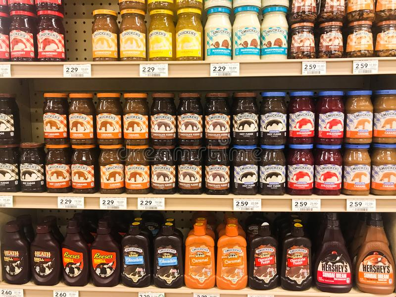 Ice Cream Toppings for Sale at a Grocery Store stock images