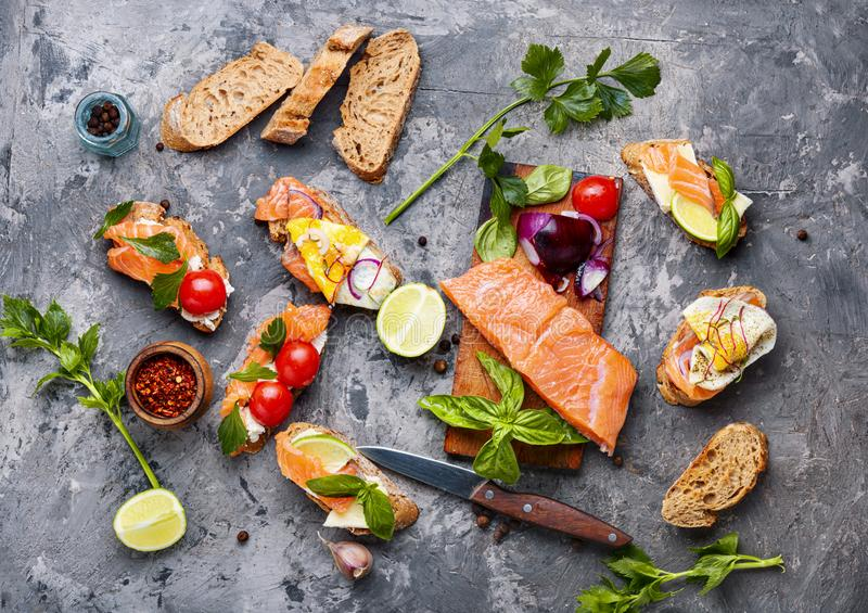 Assorted bruschetta or canape. Traditional italian bruschetta or canape.Open sandwich with salmon and ingredients royalty free stock photography