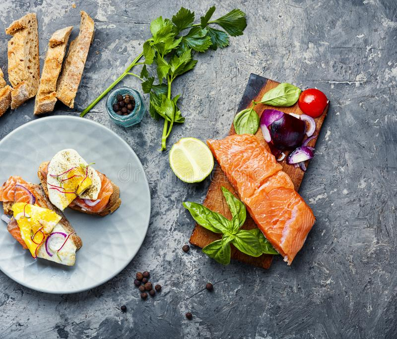 Assorted bruschetta or canape. Traditional italian bruschetta or canape.Open sandwich with salmon and ingredients stock photos