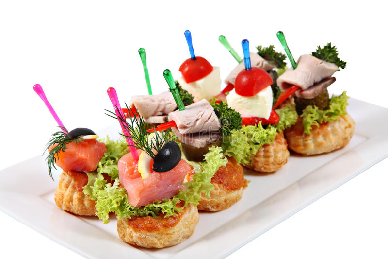 Assorted canapes sandwiches on plate over white background for Canape sandwiches