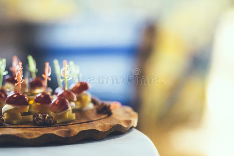 Assorted canapes on table closeup stock images