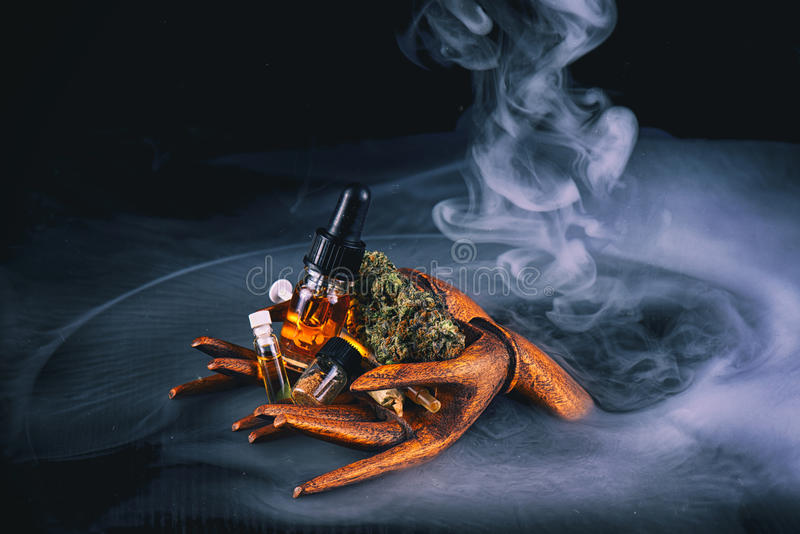 Assorted cannabis oil containers with CBD, live resin and other stock photo