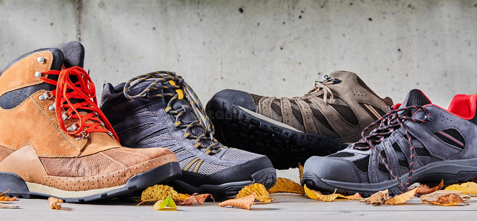 Assorted casual sneakers and leather boots royalty free stock photography