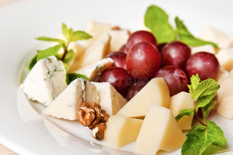 Assorted cheese plate royalty free stock images