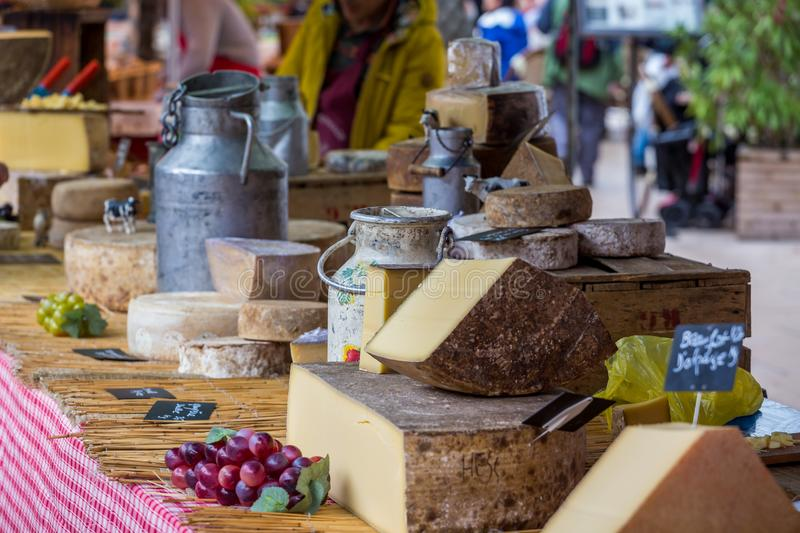 Assorted cheeses on market stall. Assortment of large cheeses on a market stall royalty free stock image