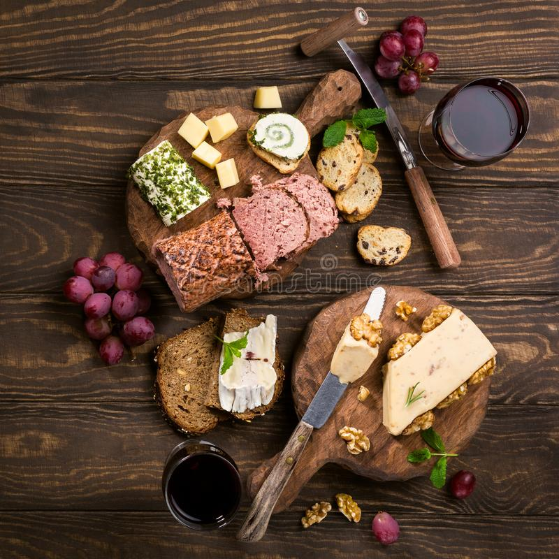 Assorted cheeses on wooden board stock image