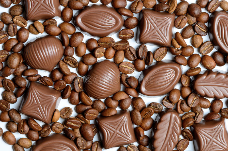 Assorted chocolate candy on the background of coffee beans isolated royalty free stock image