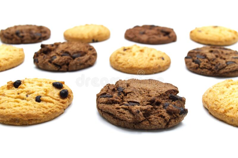 Assorted Chocolate chip cookies isolated on white background. Sweet biscuits delicious and crunchy homemade pastry royalty free stock image
