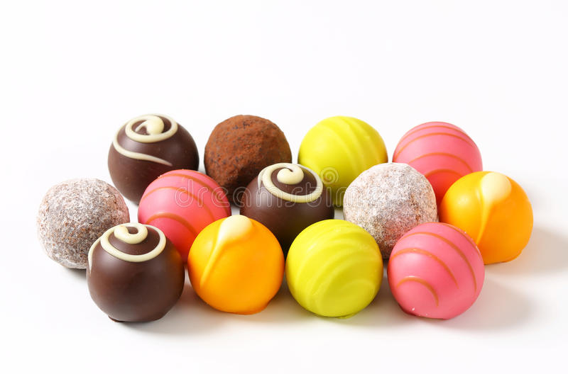 Assorted chocolate truffles and pralines. Assorted chocolate truffles and fruit ganache pralines stock photos