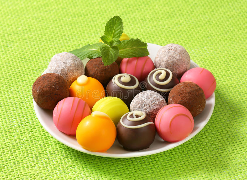 Assorted chocolate truffles and pralines. Assorted chocolate truffles and fruit ganache pralines royalty free stock photos