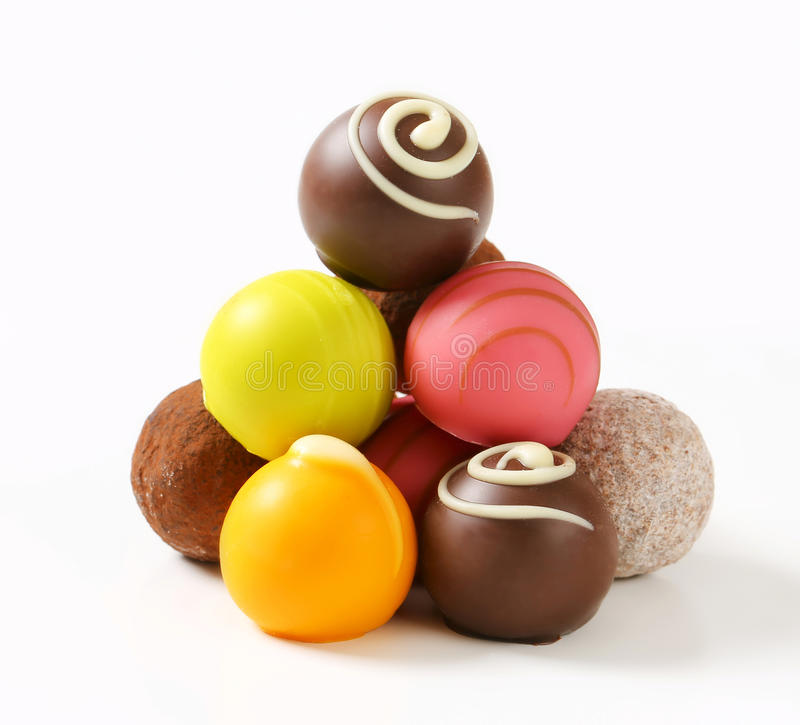Assorted chocolate truffles and pralines. Assorted chocolate truffles and fruit ganache pralines royalty free stock photography